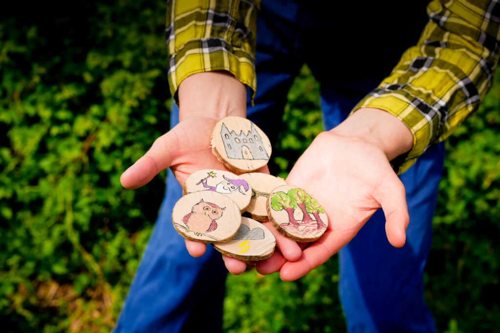Story discs in Rosemary's hands, Storyland © Drew Worthley/Brambledash